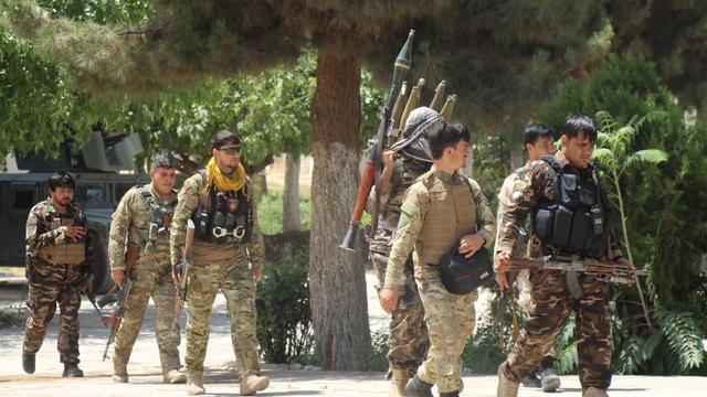Afghan security forces are seen at the site of a battle field where they clash with the Taliban insurgent in Kunduz province