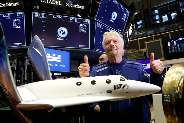 FILE PHOTO: Sir Richard Branson poses on floor of New York Stock Exchange (NYSE) ahead of Virgin Galactic (SPCE) trading in New York