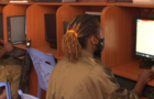 a-woman-works-in-an-internet-cafe-in-nairobi-kenya.png