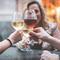 Friends Toasting Wineglasses In Restaurant