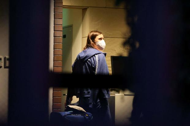 Belarus Olympian Krystsina Tsimanouskaya, who claimed her team tried to force her to leave Japan, walks with her luggage inside the Polish Embassy in Tokyo on August 2, 2021.