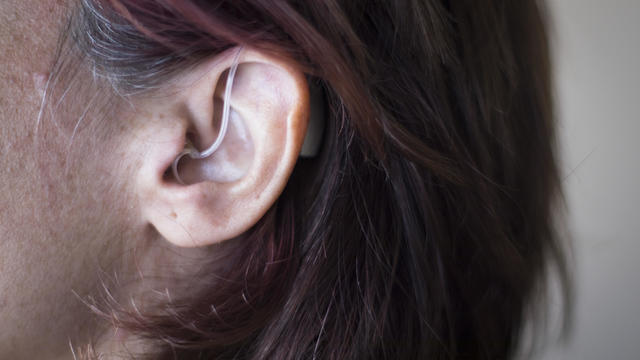Close-Up Of Woman Wearing Hearing Aid