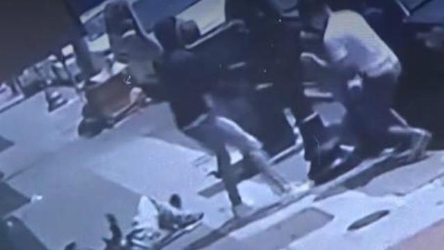 oakland-chinatown-robbery-and-shooting-on-080721-caught-on-camera-victim-lies-on-ground.jpg