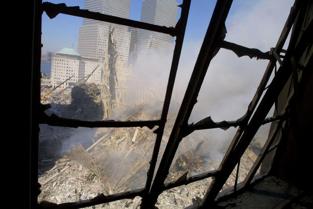 Rescue Workers Search Through WTC Rubble