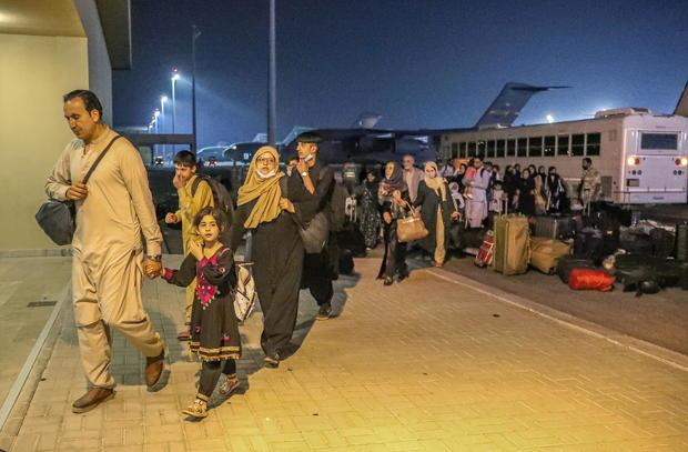 Evacuees from Afghanistan arrive at Al-Udeid airbase in Doha