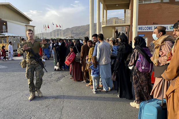 Afghans prepare to board U.S. military flights to leave Kabul and the Taliban