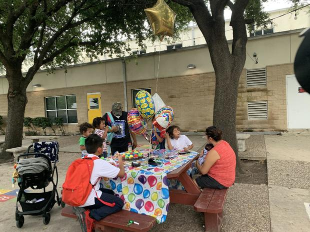 family-birthday-celebration-at-the-salvation-army-shelter-courtyard.jpg