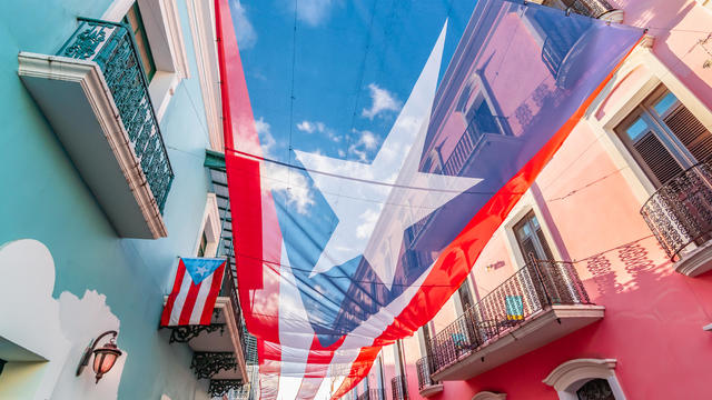 Large flag of Puerto Rico above the street in the city center of San Juan.