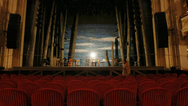 A ghostlight, a lone bulb on a stand, illuminates the stage at the Royal Alexandra Theatre