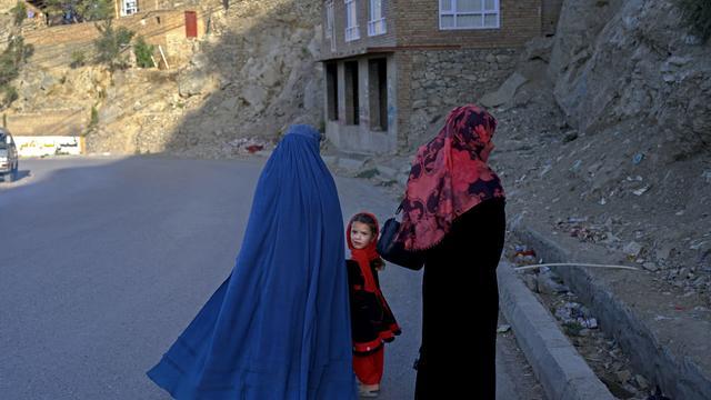 Women walk in Kabul, Afghanistan