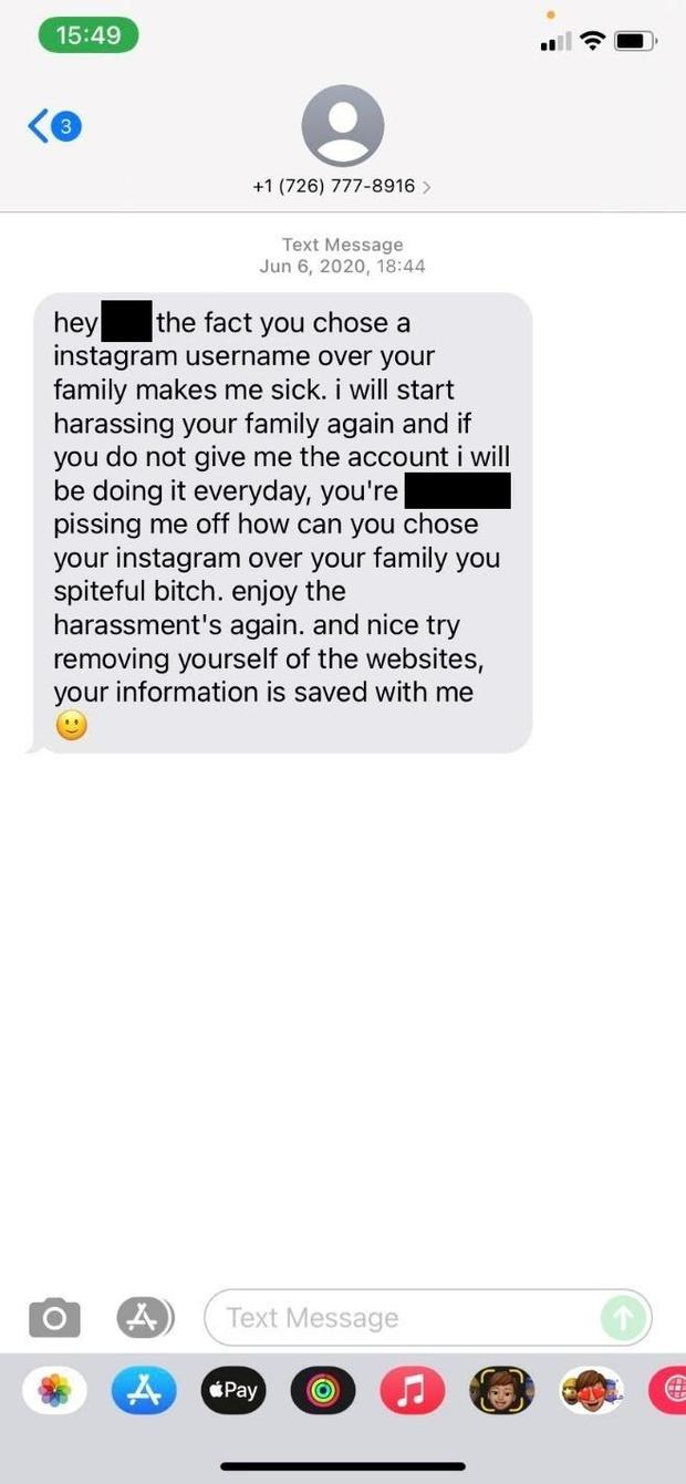 This screenshot shows a harassing text message received by a social media user who refused to give up her username.