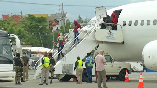 migrants-arrive-back-in-haiti.jpg
