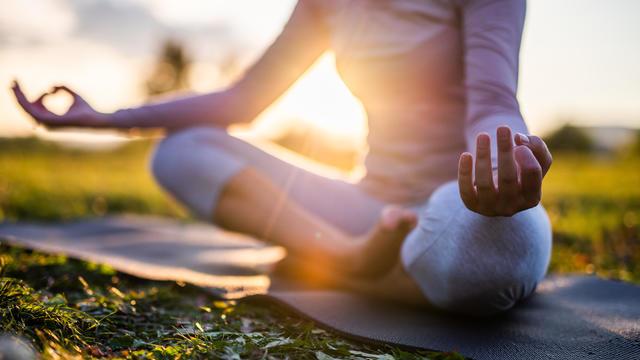 Woman practicing yoga and meditation