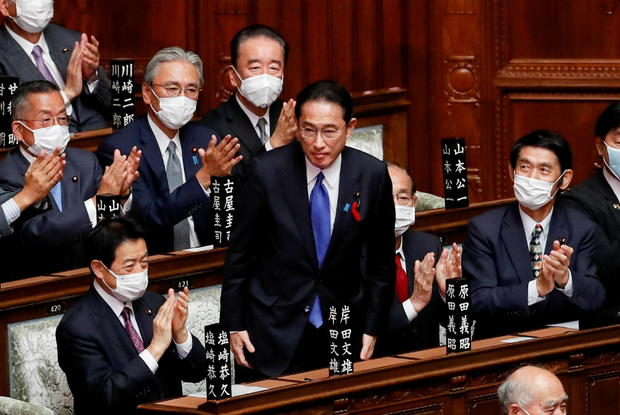 Japan's newly-elected Prime Minister Fumio Kishida is applauded after being chosen as the new prime minister, at the Lower House of Parliament in Tokyo