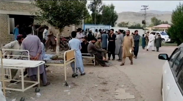 Social media video still of people gathering outside a hospital following an earthquake in Harnai, Pakistan