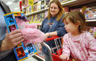Sadie Cole, 21 months old, looks at a toy her mom Danielle C