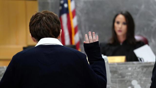 Parkland school shooter Nikolas Cruz is sworn in before pleading guilty on all four criminal counts stemming from his alleged attack on a Broward County jail guard in November 2018, in Fort Lauderdale, Florida, October 15, 2021.