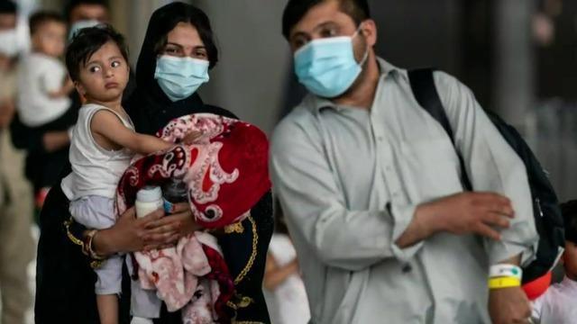 cbsn-fusion-afghan-evacuees-begin-resettlement-in-u-s-thumbnail-821630-640x360.jpg